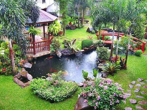 Chinese Backyard Design stock photo chinese garden korean asian japanese with a wood bridge and some colorful nice flowers and a big fresh green gras meadow Backyard Ideas On A Budget