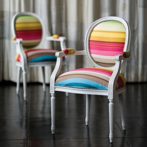 A classic style chair upholstered in the most yummy colorful striped fabric. I would redo my entire home to make these work!