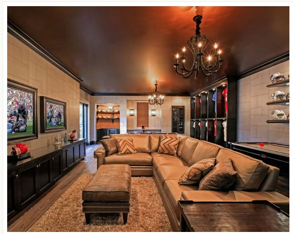 Narrow room that works perfectly with all the memorabilia, multiple TVs and lavish seating.