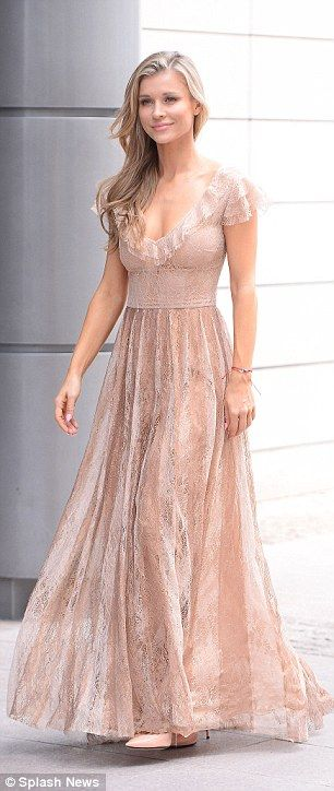She's got a lot of front: The blonde beauty flashed a peek of her cleavage in the gown, which featured a frilled neckline and flattering cap sleeves