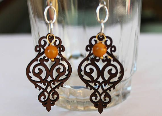 Yellow beaded earrings with laser cut brown leather intricate