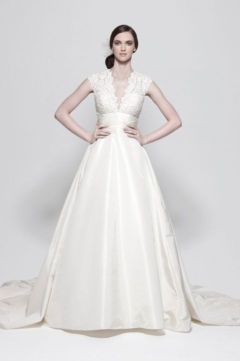 V-neck ball gown lace bridal gown.  This gown is absolutely stunning. Pinning it just because it is gorgeous