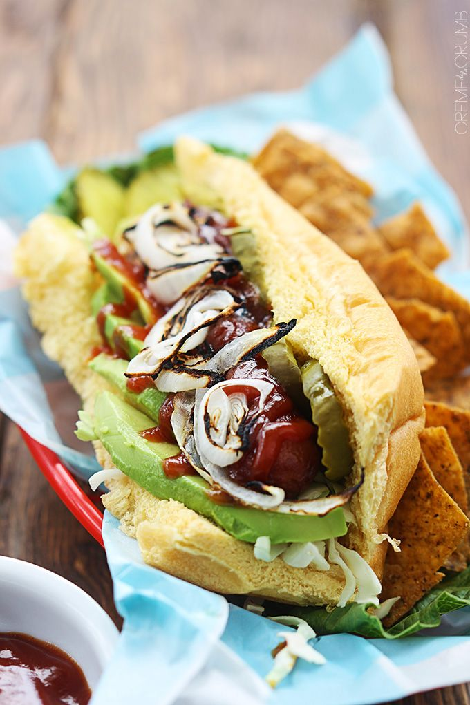The BEST all-American hot dogs with avocado, grilled onions, and a sweet and spicy bbq sauce!