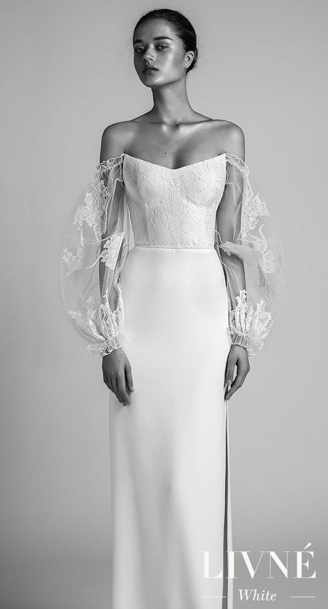 LIVNÉ WHITE – 2018 COLLECTION'RITA' WEDDING GOWN | A fitted corset wedding dress with a twist, featurnig oversized sheer lace and tulle sleeves, a high side slit skirt and a french-look lace top | Bridal Gown | #weddingdress #weddingdresses #bridalgown #bridal #bridalgowns #weddinggown #bridetobe #weddings #bride #weddinginspiration #dreamdress #fashionista #weddingideas #bridalcollection #bridaldress #fashion #bellethemagazine #ido #dress