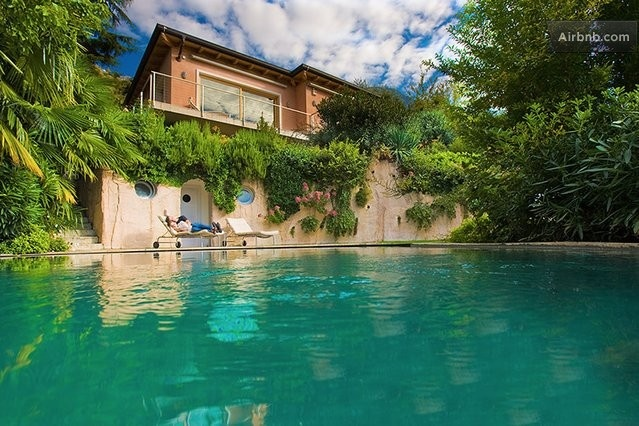 Do you prefer the lake? A modern villa, completely renovated is available with a swimming pool and a stunning views of the Garda Lake. The villa is located a mile from the town of Malcesine, with its medieval castle and it's approximately in the middle between Milan and Venice. #travel #italy #airbnb