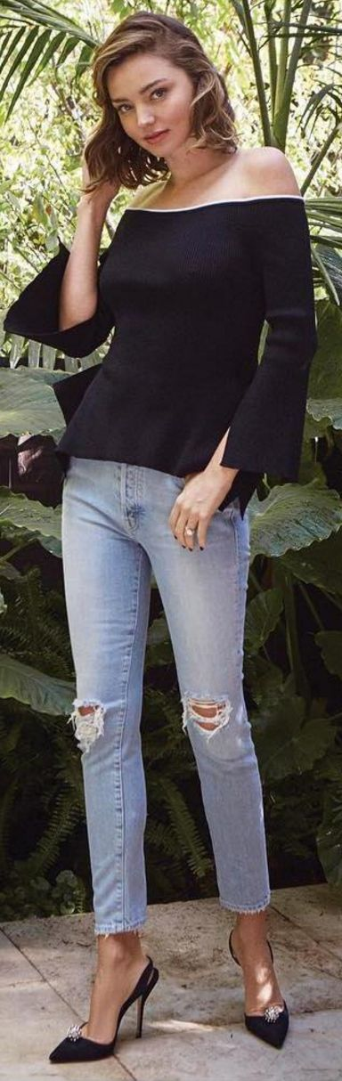 Who made  Miranda Kerr's black off the shoulder top, blue skinny ripped jeans, and crystal pumps?