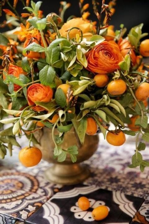 "When I hear ""#Sicilian #wedding"" , I think #baroque #orange and this #centrepiece with orange #buttercups and #mandarins is a perfect summary :) Nota bene the #sicilian #majolicas of the table! bebtrapanilveliero.it"