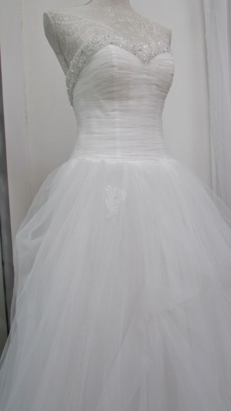 The bodice detail adds to the princess quality of this dress...
