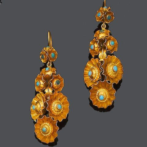 A pair of mid 19th century turquoise pendent earrings, circa 1870 Designed as a series of floral clusters, each delicate textured surround with a central cabochon turquoise highlight, later hook fittings, length 6.2cm