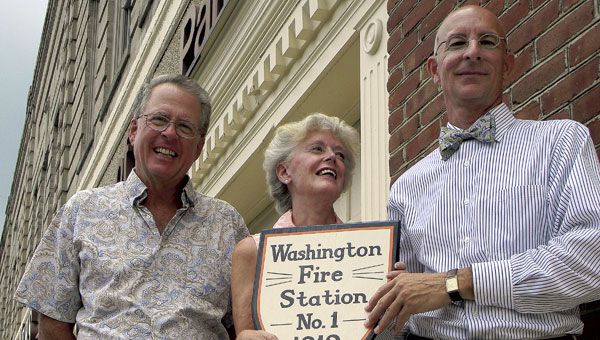 Bill Sykes (left) and Scott Campbell, owners of Fire Station Lofts, were awarded a plaque recognizing the historical significance of their building on Market and Third streets from Dee Congleton, Washington Area Historical Foundation v.p. (WDN Photo/Vail Stewart Rumley)A piece of Washington history was recognized Friday when a former shirt factory, fire station, fledgling community college and now private residence was the recipient of a plaque commemorating the building's century mark.
