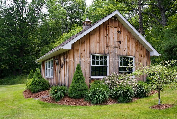 landscaping with evergreens | large wooden shed building office with evergreen foundation plants and ...