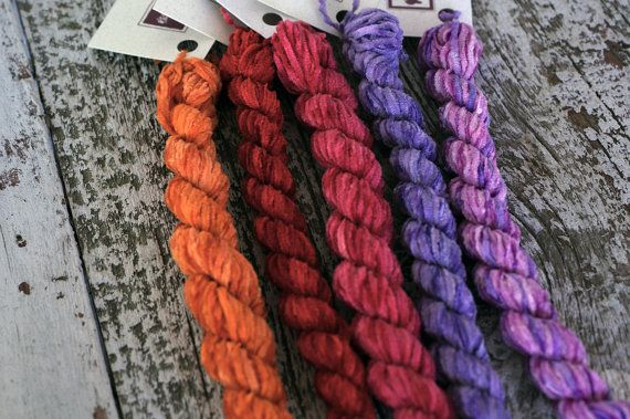 Silken Chenille is a 100% Silk Chenille Thread hand dyed by us. You are purchasing 1 skein of this thread. Choose from the variable, drop down menu. Colors from L to R are: Orange Grove, Pagoda Red, Turkey Red, Lilac Blossom, Lilac Arbor. Skeins are 20 yards each. A beautiful thread for surface couching, wool applique, needlepoint. It makes beautiful spider web roses, colonial knots and many other applications. If you purchase $75 from our shop we will ship your order free (US mailing only).