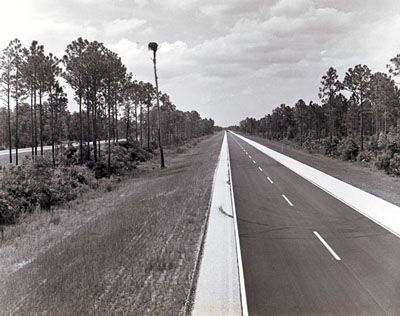 Interstate 95 — the main highway on the U.S. East Coast — in Brevard County shows the wooded median and roadside areas preserved by the Florida Department of Transportation. (Florida Department of Transportation | Federal Highway Administration)