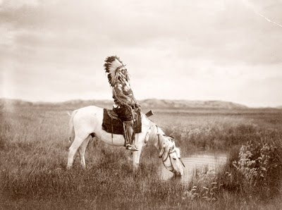 Edward Curtis photograph from 1905. The picture shows Red Hawk, an Oglala Indian on a horse at a pool of water. This is really an incredible photograph capturing a bygone era.