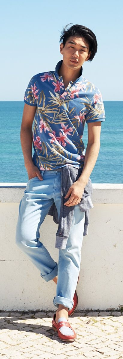 Shop this look on Lookastic:  https://lookastic.com/men/looks/grey-hoodie-blue-polo-light-blue-jeans-white-and-red-loafers/11639  — Blue Floral Polo  — Grey Hoodie  — Light Blue Jeans  — White and Red Leather Loafers