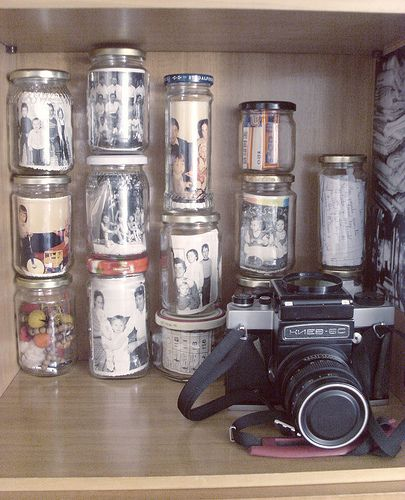 LOVE this idea of old photos in canning jars.  Paired with a vintage camera.  Perfect-o!