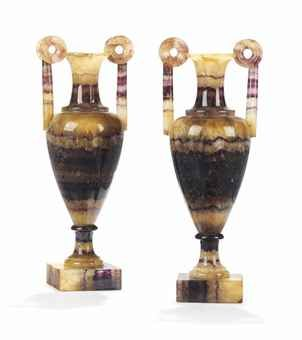 A PAIR OF REGENCY BLUE-JOHN SLENDER VASES  EARLY 19TH CENTURY  Each with an everted rim and ring handles above a tapering body and square plinth  8¼ in. (19.5 cm.) high (2)