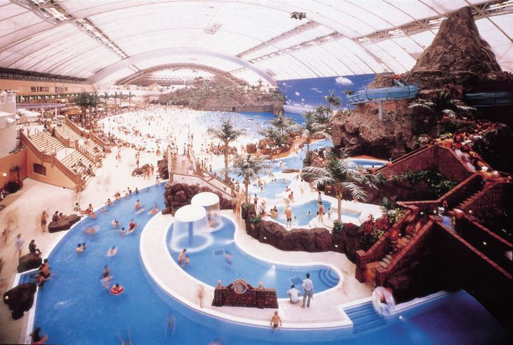 The world's largest indoor water park: Seagaia Ocean Dome, Miyazaki  300 m long & 100 m wide. The dome features a retractable roof, but the ceiling provides a perfect blue sky. The air temperature 30°C (85°F) & water temperature 28°C. Flame-spitting volcano, hi-tech wave machinery, crushed white marble sand, tennis courts, golf courses & zoo with an impressive collection of animals, ranging from ring-tailed lemurs to indian wood storks.
