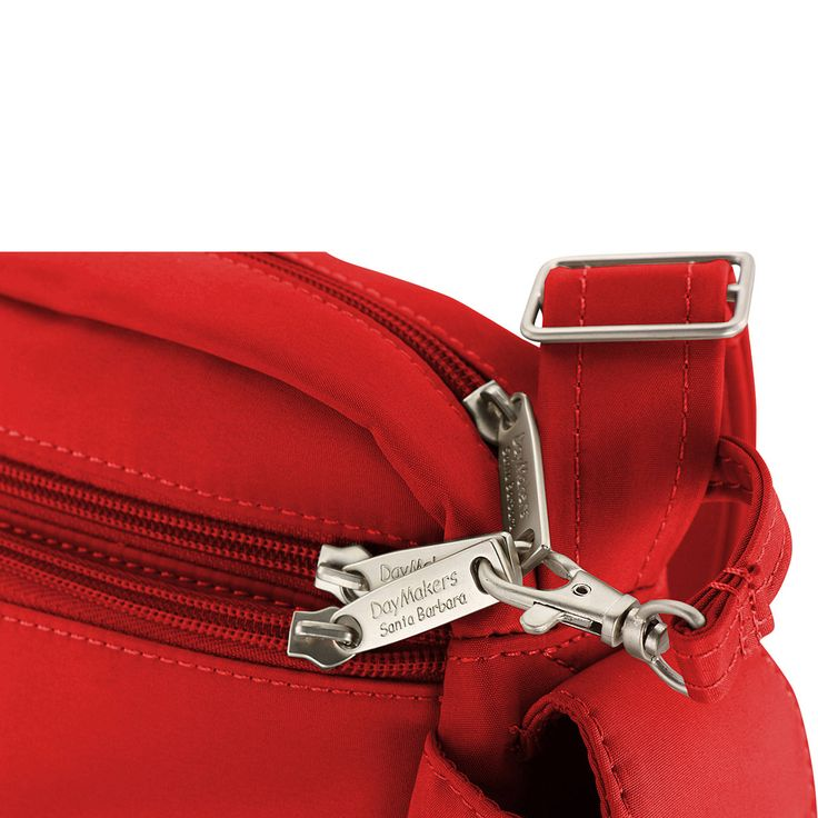 """This medium vertical Anti-Theft security bag is great for travel and around town. With a comfy non-slip shoulder pad It can be worn on the shoulder or cross body. Security features include a pair of 1/16"""" aircraft cables in the slice-proof adjustable strap and a zipper security leash that extends from the main compartment for the external zippers. Seven pockets include an outside zipper with pleated lining accommodating bulky objects (with a double ended leash for keys and an includ..."""