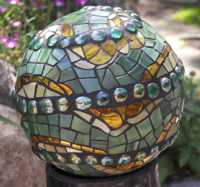 Garden Art Ideas find this pin and more on garden art ideas Recycle Bowling Balls Into Mosaic Garden Art