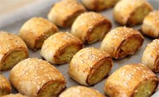 These chicken sausage rolls  have a lovely puffy crust and hidden veggies inside. They are great party food.