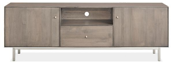 Don't let Hudson's delicate design fool you - it's built to be rock solid. This modern media cabinet is handcrafted in West Virginia by skilled artisans, who share their pride by signing the back of each Hudson piece they create. The natural grain pattern of U.S.-sourced solid wood is the perfect backdrop for the sleek, timeless design of this media cabinet. From a distance you'll appreciate how seamlessly this minimalist design incorporates into any space. Up close, you'l...