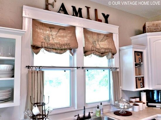 burlap kitchen curtains Im so happy with the result and it was so stinkin easy! How great was it that the coffee sacks fit the width of the window perfectly. All I did was attach them to the inside of the window trim with screws, bunch up the fabric and tie it with hemp twine that I already had. Simple and cheap!