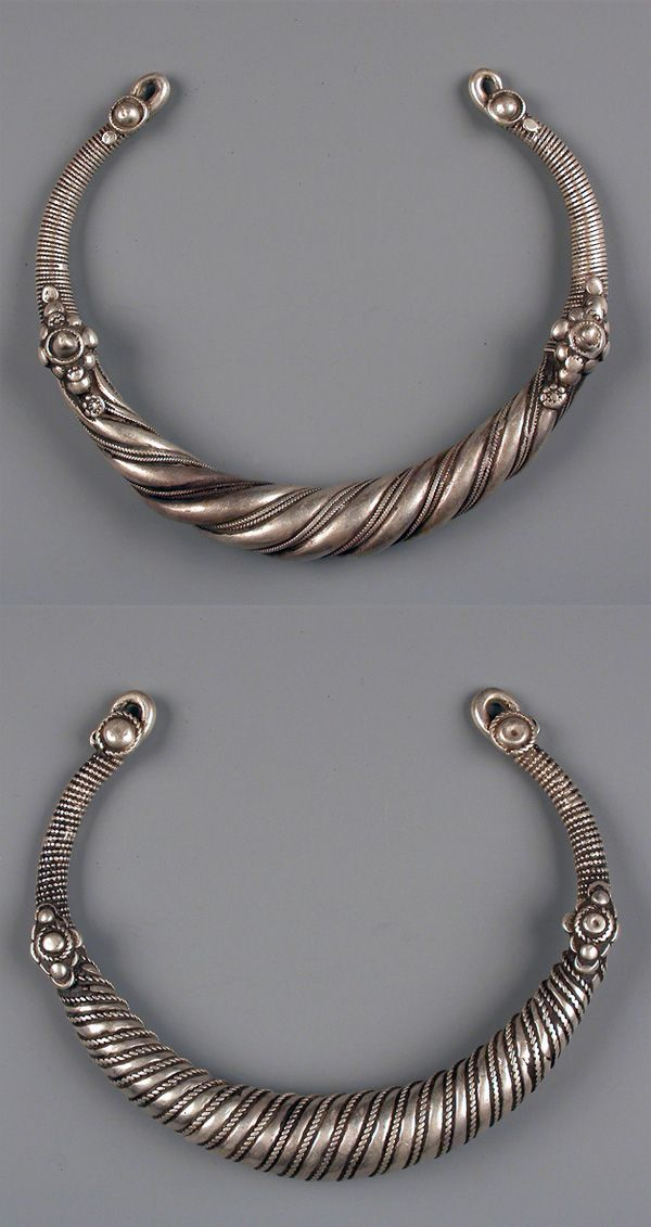 North West Pakistan | Silver neck torques worn by married women in Swat valley | ©Karun Collection
