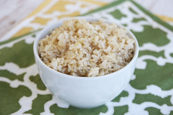 I know, I know…by the title you're expecting the most exciting blog post, EVER.  Right? Stick with me.  To pump up the excitement factor, I'm giving away something super cute, too.  You'll want one.  But let's talk brown rice for a minute, shall we?  Brown rice is a whole grain.  It's a plain grain of rice with only the outer husk removed.  To produce normal, white rice, the next 2 layers (the bran and the germ) are removed, leaving just …
