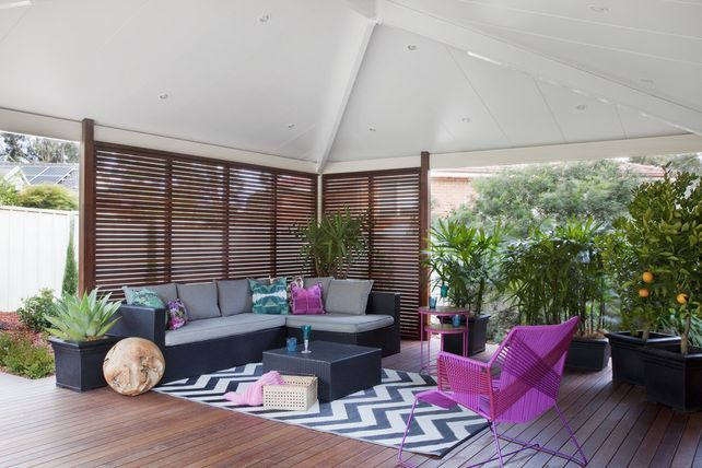 Gorgeous outdoor living space styled perfectly with a pop of colour. Entertain your family and friends all summer and winter long in the perfect sheltered area. This outdoor space is covered by Shademasters insulated roofing to ensure total temperature comfort whilst entertaining! #patio #design #outdoor #living #entertainment #furniture #BBQ #home #insulated #roofing