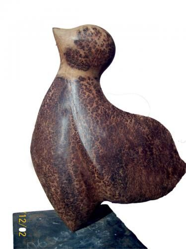 """THE MOINEAU WOOD CARVED SCULPTURE The """"MOINEAU"""" is a sculpture carved in Thuya wood. Length 52 cm, Width 45 cm, and Weight 10 Kg. Ref. Number: D-006 The sculpture expresses a kind of birds that brings good news."""