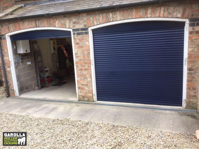 Roller Shutter Garage Door In Blue Garage Door Styles Garage Doors Uk Garage Door Design