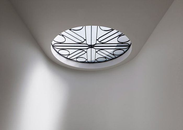 SCREENS & SHUTTERS: The Other Window Treatments  |  A decorative metal screen adorns a skylight in a home by b.e Architecture.