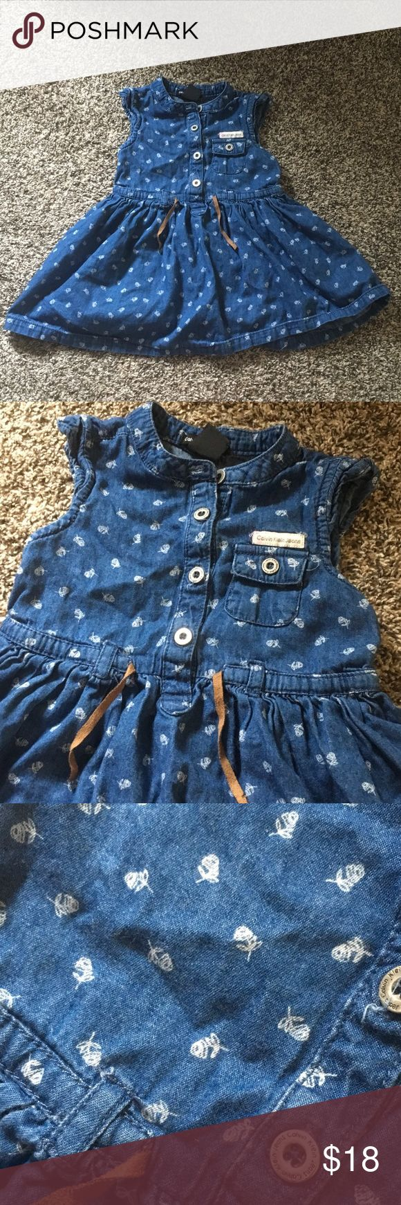 SALE! Calvin Klein Girls Dress Calvin Klein Girls Jean material Dress with white rose print, also comes with dress underwear, worn a few times in great condition. Size 2T. Light pink stain on Calvin Klein logo but it's hardly noticeable Calvin Klein Dresses Casual
