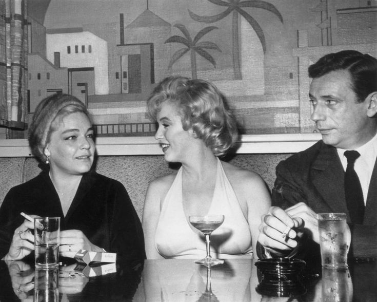 "Simone Signoret and Yves Montand, with Marilyn Monroe sitting between them - during the filming of ""Let's Make Love""  - Let the fireworks begin!!!"