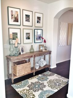 Home entry way. World market table with tj max accessories ...cheap and cute! Photos of our travels on wall.