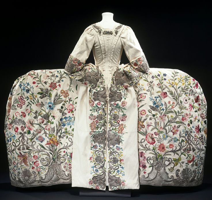 """""""'Court dress' was an exclusive and very ornate style of clothing worn by the aristocracy, the only people usually invited to attend at Court. The style of the robe is quite old-fashioned, and based on the 17th-century mantua."""""""