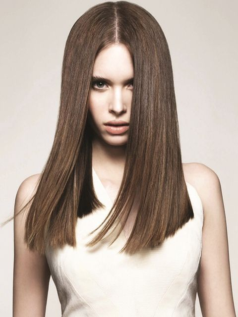 This lovely brunette solid form visibly shows from the interior to the exterior the same length all over. Such a great model shot for a solid form hair description.