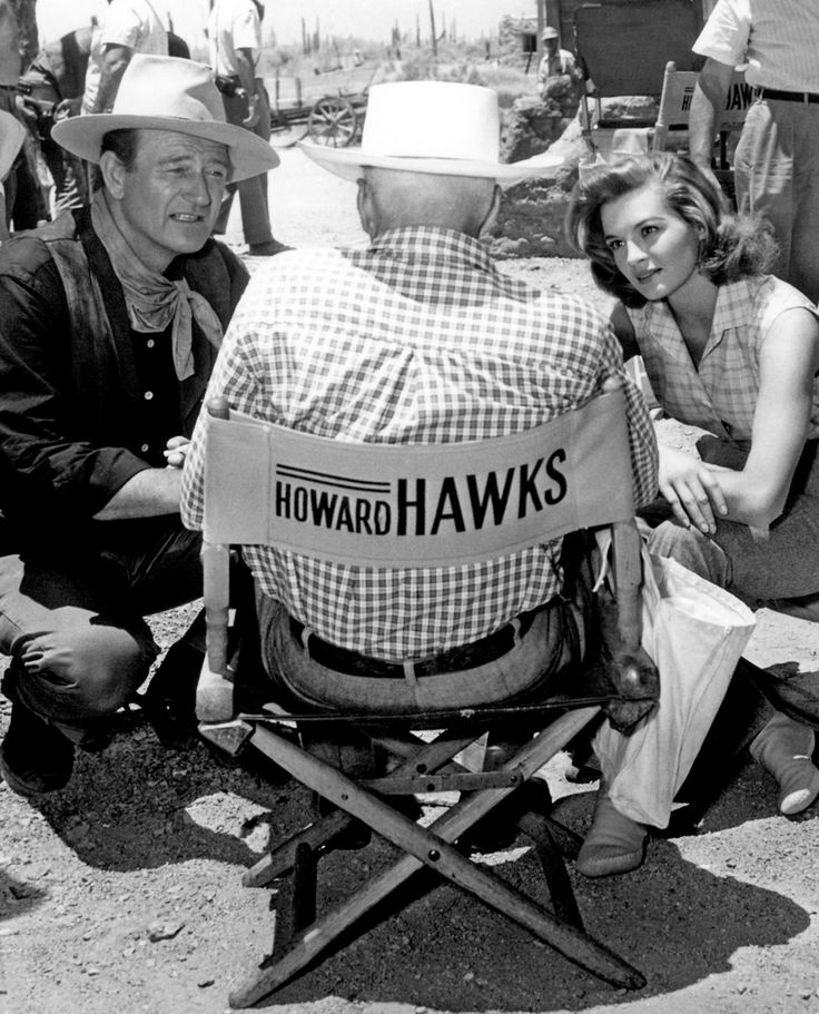 "John Wayne,  Angie Dickinson and Director Howard Hawks on the set of ""Rio Bravo"" (1959)."