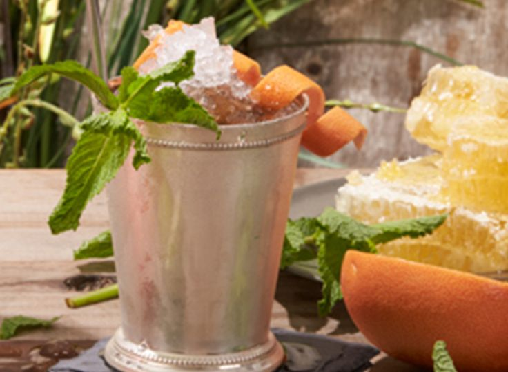 Try a Mint Julep and grapefruit using Ketel One® Vodka, lime, grapefruit juice, pomegranate syrup, mint & honey syrup.