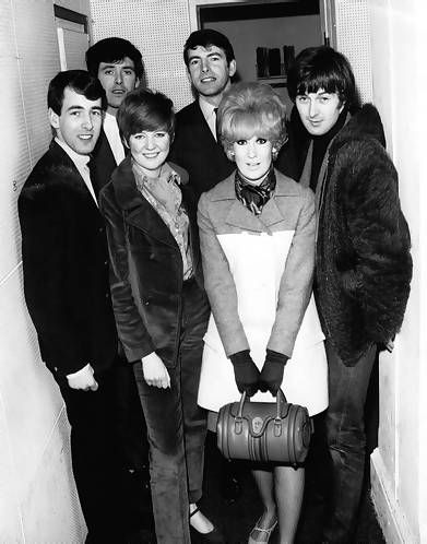 1960s Photograph taken at the offices of Radio Caroline featuring The Bachelors with Cilla Black, Dusty Springfield and Spencer Davis.