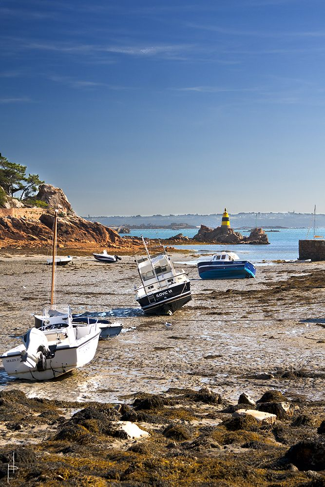Ile de Bréhat (Britanny, France) Such an incredibly beautiful island of pink rocks, car-less roads, and lighthouses