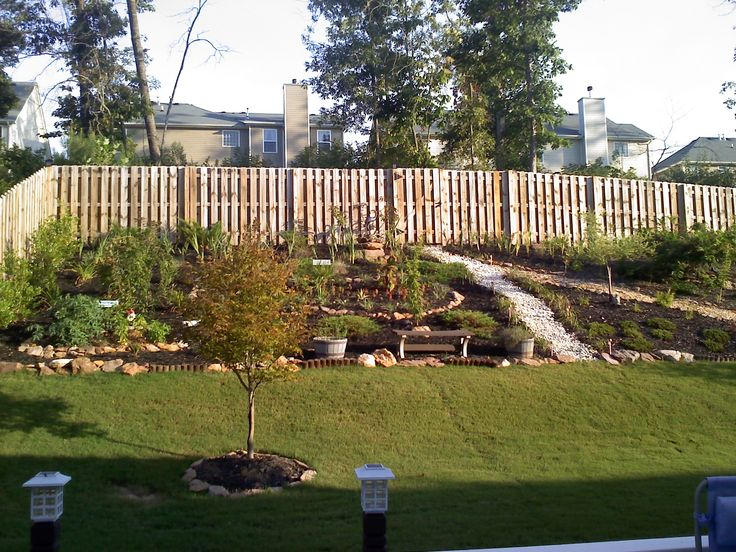 steep sloped back yard landscaping ideas should we install a retaining wall in our backyard. Black Bedroom Furniture Sets. Home Design Ideas