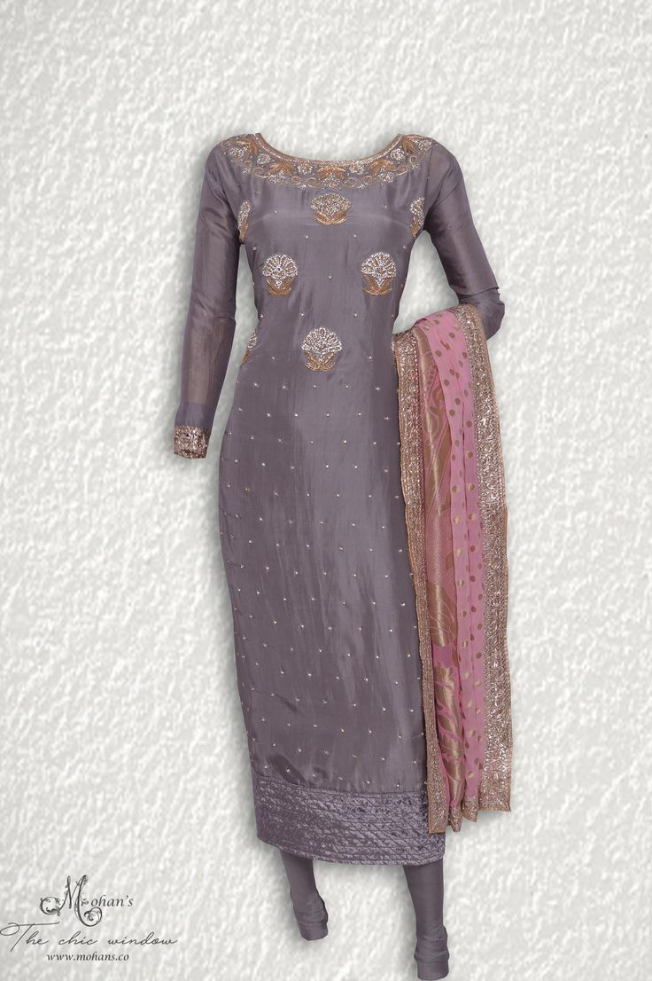 Exquisite silver grey suit adorn in stone and dabka work