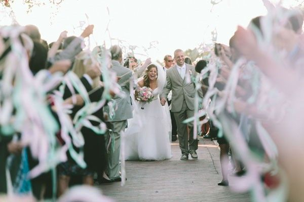 Wands are the best of both worlds: streaming color for your send off and no mess to clean up later. | See more exit ideas for your #wedding here: http://www.mywedding.com/articles/wedding-exit-ideas/?utm_source=pinterest&utm_medium=social&utm_campaign=wedding_whims