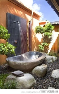 A cool outdoors shower-bath combo.