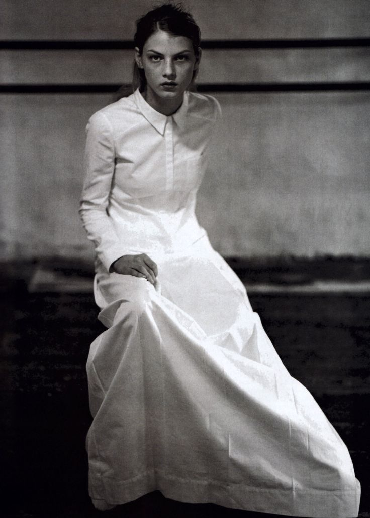 En robe longue : Miu Miu : American Vogue : March 1997.