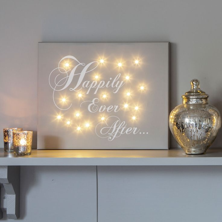 Tied the knot? About to pop the question? Say it with this canvas – a keepsake that'll last a lifetime... Everyone loves fairy lights, so why save them just for Christmas? Now you can add a magical glow to any room – at any time of the year – with our personalised illuminated canvases, this one in particular being a great choice for a special couple.