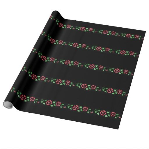 Red roses on black gift wrap.