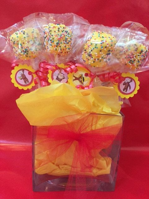 This is for a set of 12 Yellow chocolate covered Marshmallow pops with rainbow bead sprinkles. Curious George character tags and red curly